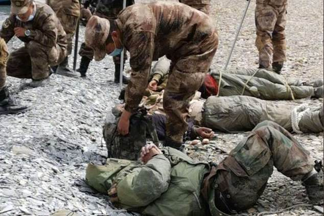 Pictures which circulated earlier this year appeared to show Indian troops battered and bound with rope near the disputed Himalayan border, where China is said to have used a microwave-style weapon to disperse hostile soldiers in August
